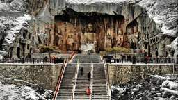 In pics: snow-covered Longmen Grottoes in Luoyang, C China's Henan
