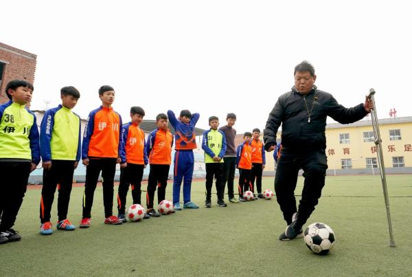 Rural teacher defies setbacks, chases soccer dream