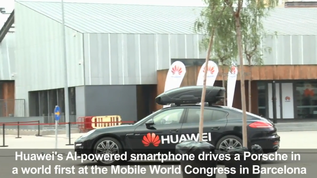 China's Huawei used the AI on its smartphone to drive a sports car during the Mobile World Congress in Barcelona_fororder_QQ截图20180228112828
